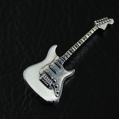 Japan import, refined minature 925 Sterling Silver guitar pendant
